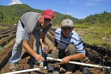Joe and Pastor Luis repairing a busted irrigation pipe