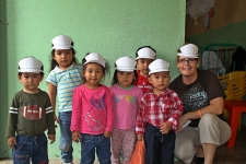 Sandi hanging with the pre-schoolers who live in some extreme poverty