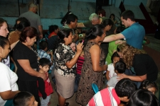 Praying for members at a local church outreach